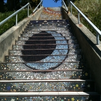 Sun & moon tiled in to the very top of the stairway
